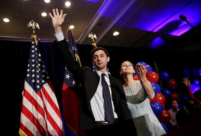 Democratic candidate for 6th congressional district Jon Ossoff, left, concedes to Republican Karen Handel while joined by his fiancee Alisha Kramer at his election night party in Atlanta, Tuesday, June 20, 2017. (AP Photo/David Goldman)