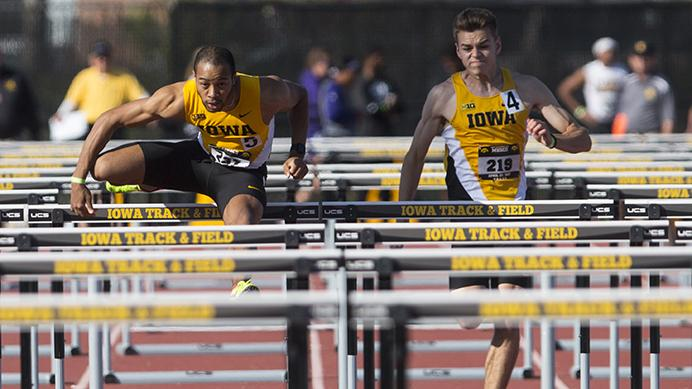 Iowa's Aaron Mallett clears a hurdle alongside teammate Chris Douglas during the 18th annual Musco Twilight at Francis X. Cretzmeyer Track on Saturday, April 22, 2017. Iowa's men and women's track and field finished first overall in the Musco Twilight with a 237.5 and 203 respectively. (The Daily Iowan/Joseph Cress)
