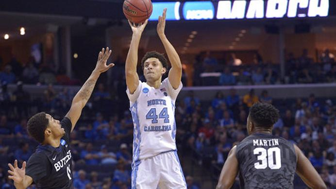 FILE - In this March 24, 2017, file photo, North Carolina forward Justin Jackson (44) shoots over Butler guard Kethan Savage (11) as Butler forward Kelan Martin (30) looks on in the first half of an NCAA college basketball tournament South Regional semifinal game, in Memphis, Tenn. ackson significantly improved his outside shooting at North Carolina to make himself into a first-rounder in Thursdays NBA draft. (AP Photo/Brandon Dill, File)