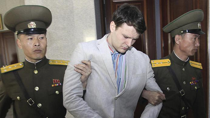 FILE - In this March 16, 2016, file photo, American student Otto Warmbier, center, is escorted at the Supreme Court in Pyongyang, North Korea. The death last week of American student Warmbier, who fell into a coma after being arrested in North Korea, has raised questions about whether his tour agency was adequately prepared for its trips into the hard-line communist state. The Young Pioneer Tours agency built up a business attracting young travelers with cut-rate, hard-partying adventures into one of the world's most isolated countries. (AP Photo/Jon Chol Jin, File)