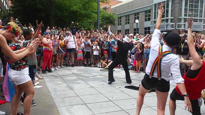 FILE - The crowd gives the performer an applause on the Weatherdance Fountain Stage in the Ped Mall in Iowa City on Saturday, June 17, 2017. (The Daily Iowan/ Alex Kroeze)