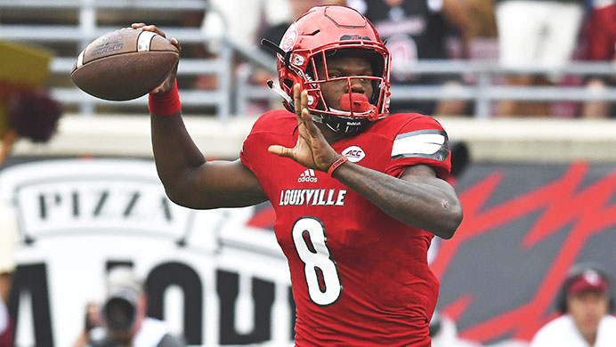 FILE - In this Saturday, Sep. 17, 2016, file photo, Louisville quarterback Lamar Jackson looks for a receiver during the first quarter of an NCAA college football game against Florida State, in Louisville Ky.  Florida State is the preseason pick to win the Atlantic Coast Conference and reigning Heisman Trophy winner Lamar Jackson of Louisville is the preseason player of the year. The ACC announced voting results Monday, July 17, 2017,  following a poll of 167 media members who attended last weeks media days in Charlotte. (AP Photo/Timothy D. Easley, File)