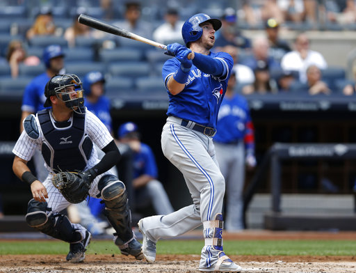 New York Yankees catcher Austin Romine, left, and Toronto Blue Jays Justin Smoak watch Smoaks two-run home run during the third inning of a baseball game  in New York, Wednesday, July 5, 2017. (AP Photo/Kathy Willens)