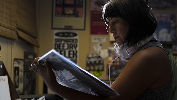 DJ Espina searches through vinyl records at Record Collector on S. Linn St. on Tuesday, July 11, 2017. Espina is one of the featured DJs performing in Middle of Nowhere Music Festival during Labor Day weekend this year. The event hosts local talent within the Iowa City electronic music scene in select venues throughout downtown. (Ben Smith/The Daily Iowan)