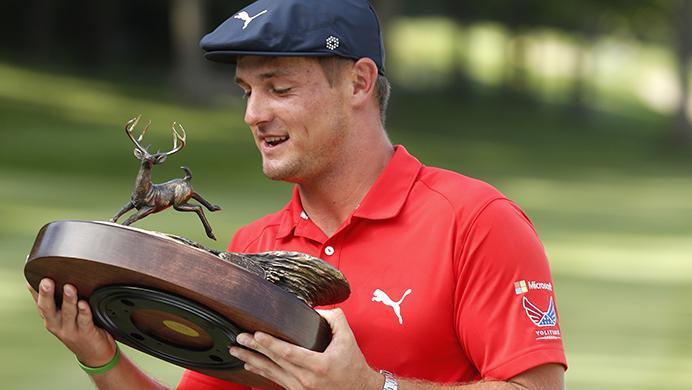 Bryson+DeChambeau+celebrates+with+the+trophy+after+winning+the+John+Deere+Classic+golf+tournament%2C+Sunday%2C+July+16%2C+2017%2C+at+TPC+Deere+Run+in+Silvis%2C+Ill.+%28AP+Photo%2FCharlie+Neibergall%29