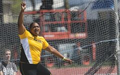 Iowa's Laulauga Tausaga watches her throw during the 18th annual Musco Twilight at Francis X. Cretzmeyer Track on Saturday, April 22, 2017. Iowa's men and women's track and field finished first overall in the Musco Twilight with a 237.5 and 203 respectively. (The Daily Iowan/Joseph Cress)