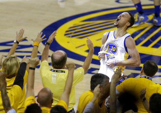 FILE - In this May 30, 2016, file photo, fans cheer as Golden State Warriors guard Stephen Curry yells after the Warriors defeated the Oklahoma City Thunder in Game 7 of the NBA basketball Western Conference finals in Oakland, Calif. One of the NBAs biggest bargains until now, Curry is about to receive his massive payday.  Golden State general manager Bob Myers said Friday, June 30, 2017, the Warriors will finalize a contract with the two-time MVP once the free agency moratorium ends July 6.  (AP Photo/Ben Margot, File)