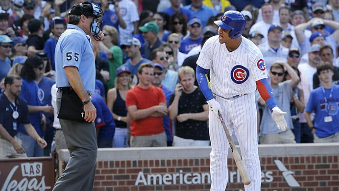 Chicago Cubs Willson Contreras, right, argues with home plate umpire Angel Hernandez after Hernandez called him out on strikes to end a baseball game against the Chicago White Sox, Monday, July 24, 2017, in Chicago. (AP Photo/Charles Rex Arbogast)