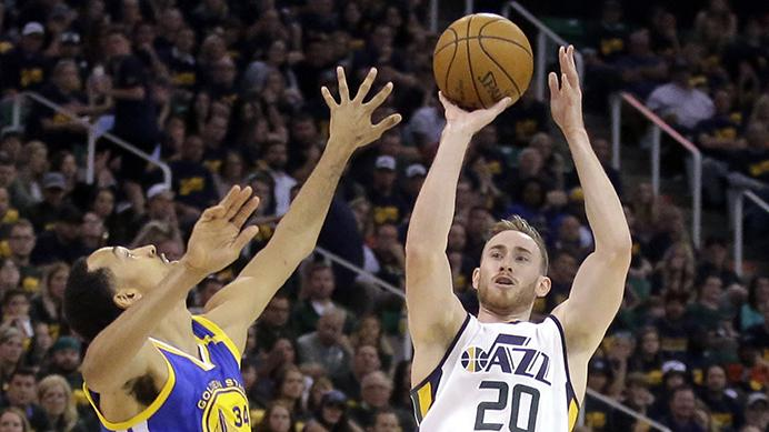 FILE - In this May 6, 2017, file photo, Utah Jazz forward Gordon Hayward (20) shoots as Golden State Warriors guard Shaun Livingston (34) defends in the second half during Game 3 of the NBA basketball second-round playoff series in Salt Lake City. Hayward has chosen to sign with the Boston Celtics and reunite with coach Brad Stevens, making the announcement Tuesday evening, July 4, on The Players Tribune site. (AP Photo/Rick Bowmer, File)