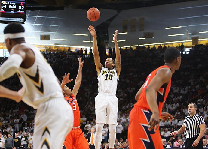 FILE - In this file photo, Iowa guard Christian Williams shoots a three against Illinois on Saturday, Feb. 18, 2017 in Carver-Hawkeye Arena. (The Daily Iowan/Joshua Housing)