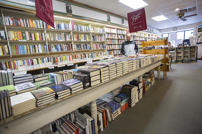 FILE - A customer shops for books at Prairie Lights Bookstore on Thursday, April 27, 2017. (The Daily Iowan/Nick Rohlman)