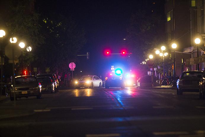 Police respond to a call of shots fired on the Ped Mall on Sunday, Aug. 27, 2017. An initial call came in around 1:30 a.m. where officers immediately responded. No University of Iowa students were injured. Two men are in custody and will be charged in relation to the events of Sunday morning. (Joseph Cress/The Daily Iowan)