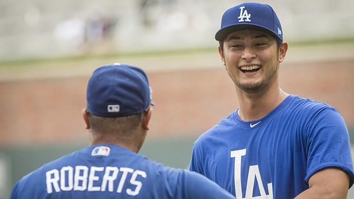 Los Angeles Dodgers Yu Darvish, right, talks to manager Dave Roberts before a baseball game against the Atlanta Braves, Wednesday, Aug. 2, 2017, in Atlanta. Darvish was recently acquired from the Texas Rangers. (AP Photo/John Amis)