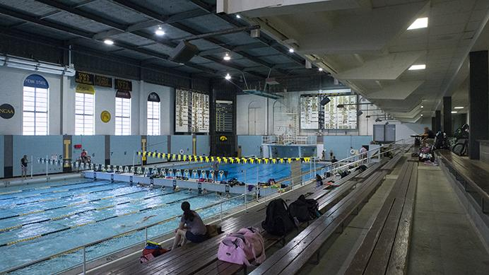 Patrons swim in the Field House pool on Tuesday. The Field house renovation plans call for the removal of the pool in order to increase the amount of space available for workout rooms. (Nick Rohlman/The Daily Iowan)