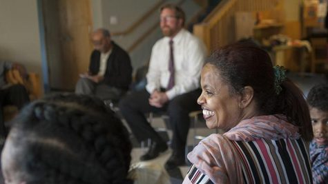 FILE - Mazahir Salih, the president of the Center for Worker Justice, laughs at a shared experience told during a listening post at the Pheasant Ridge Neighborhood Center on April 1, 2016.  (The Daily Iowan/file)