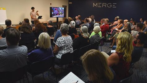 Iowa City community mebers listen to some upcoming public art projects at Merge collective workspace, Wednesday, Aug. 30 2017. The Iowa City Downtown district hosted the event to gather input from the community on possible art projects through the district. (Paxton Corey/The Daily Iowan)