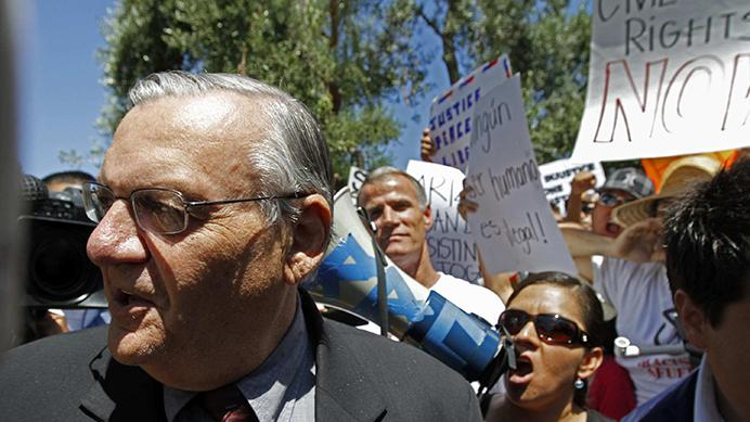 Maricopa County, Arizona, Sheriff Joe Arpaio walks through a crowd of protestors in Rancho Bernardo, California, before he addressed a standing-room only group of Conservative Voters for Good Government, on Tuesday, August 9, 2010. (Don Bartletti/Los Angeles Times/MCT)