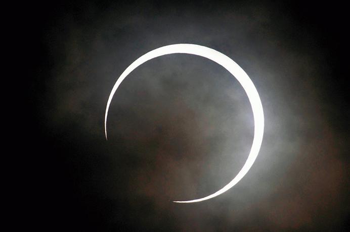 The moon begins moving away from the sun at 7:37 a.m, Monday, May 21, 2012 in Tokyo, Japan. (Yomiuri Shimbun/MCT)