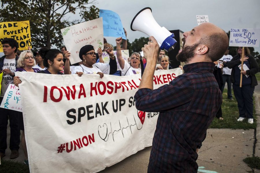 Organizers and protestors chant in support of laborers during a Labour Walkout event in Des Moines on Monday, Sept. 4, 2017. Organizations in support of laborers across Iowa such as Service Employees International Union, Iowa Citizens for Community Improvement, and Democratic Socialists of America participated in the rally. (Ben Smith/The Daily Iowan)