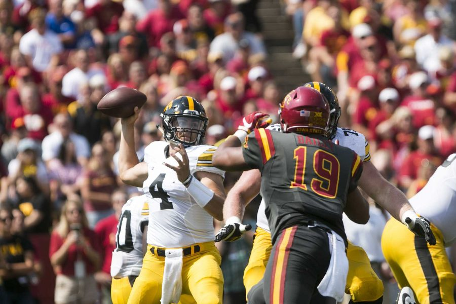Iowa quarterback Nathan Stanley throws under pressure during the Iowa/Iowa State game for the Cy-Hawk trophy in Jack Trice Stadium on Saturday, Sept. 9, 2017. The Hawkeyes defeated the Cyclones, 44-41, in overtime. (Joseph Cress/The Daily Iowan)