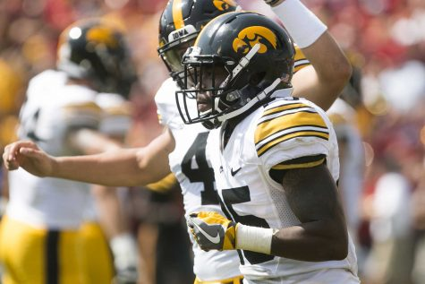 Iowa running back Akrum Wadley runs to the sideline after scoring a touchdown during the Iowa/Iowa State game for the Cy-Hawk trophy in Jack Trice Stadium on Saturday, Sept. 9, 2017. The Hawkeyes defeated the Cyclones, 44-41, in overtime.(Joseph Cress/The Daily Iowan)