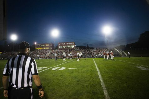 An official watches play during a 4A varsity high school football game between Iowa City High and West High at Bates Field in Iowa City on Friday, Sept. 15, 2017. (Joseph Cress/The Daily Iowan)