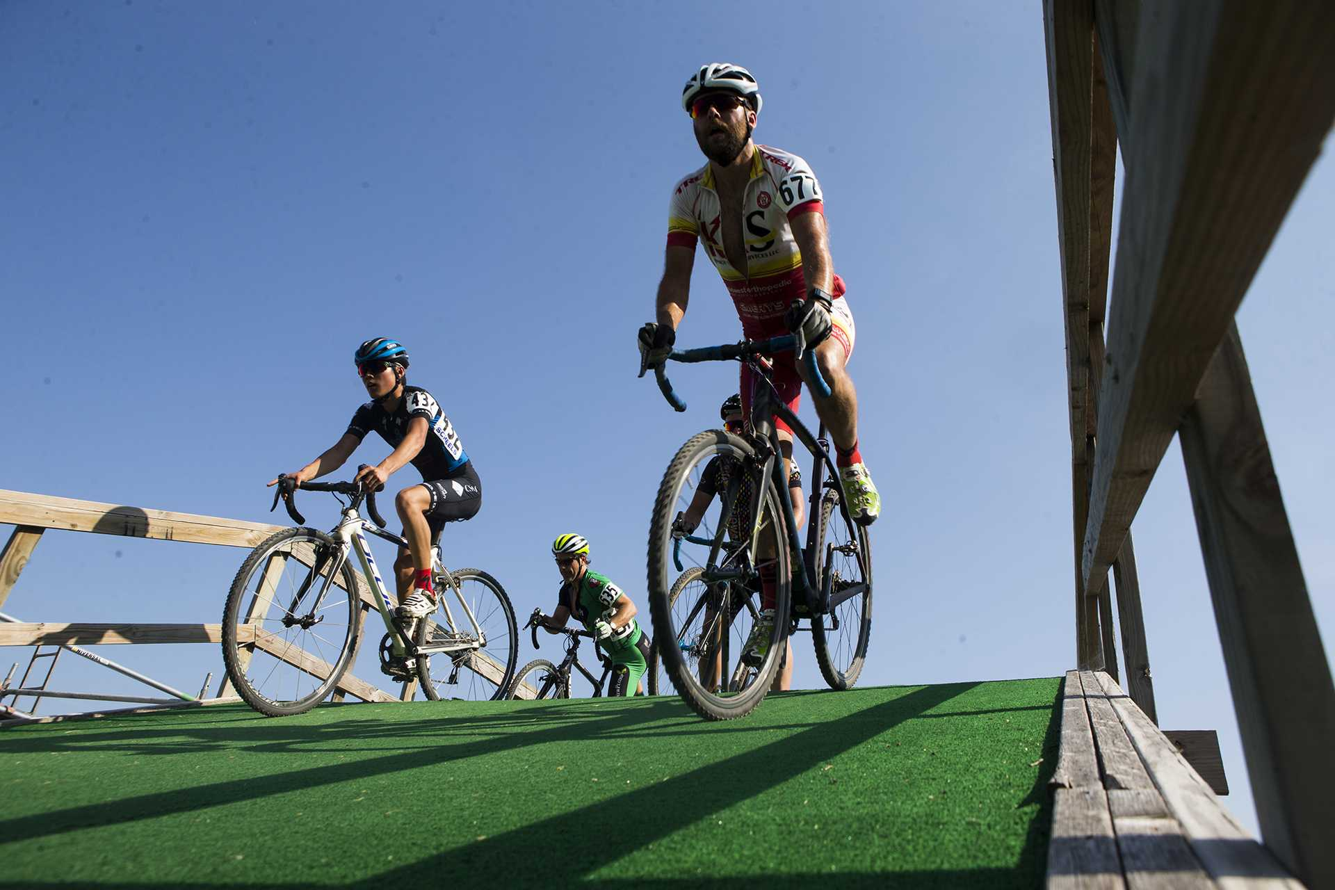 Cyclocross riders roll down a flyover during the first day of Jingle Cross at the Johnson County fairgrounds on Friday, Sept. 15, 2017. The three day cyclocross event will host events Friday night, masters ones on Saturday under the lights, and the UCI Telenet Cyclocross World Cup to close out the weekend on Sept. 17. Joseph Cress/The Daily Iowan)