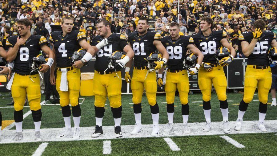 Iowa+players+stand+on+the+sideline+before+the+season+opener+against+Wyoming+on+Saturday%2C+Sep.+2%2C+2017.+The+Hawkeyes+went+on+to+defeat+the+Cowboys%2C+24-3.+%28Ben+Smith%2FThe+Daily+Iowan%29