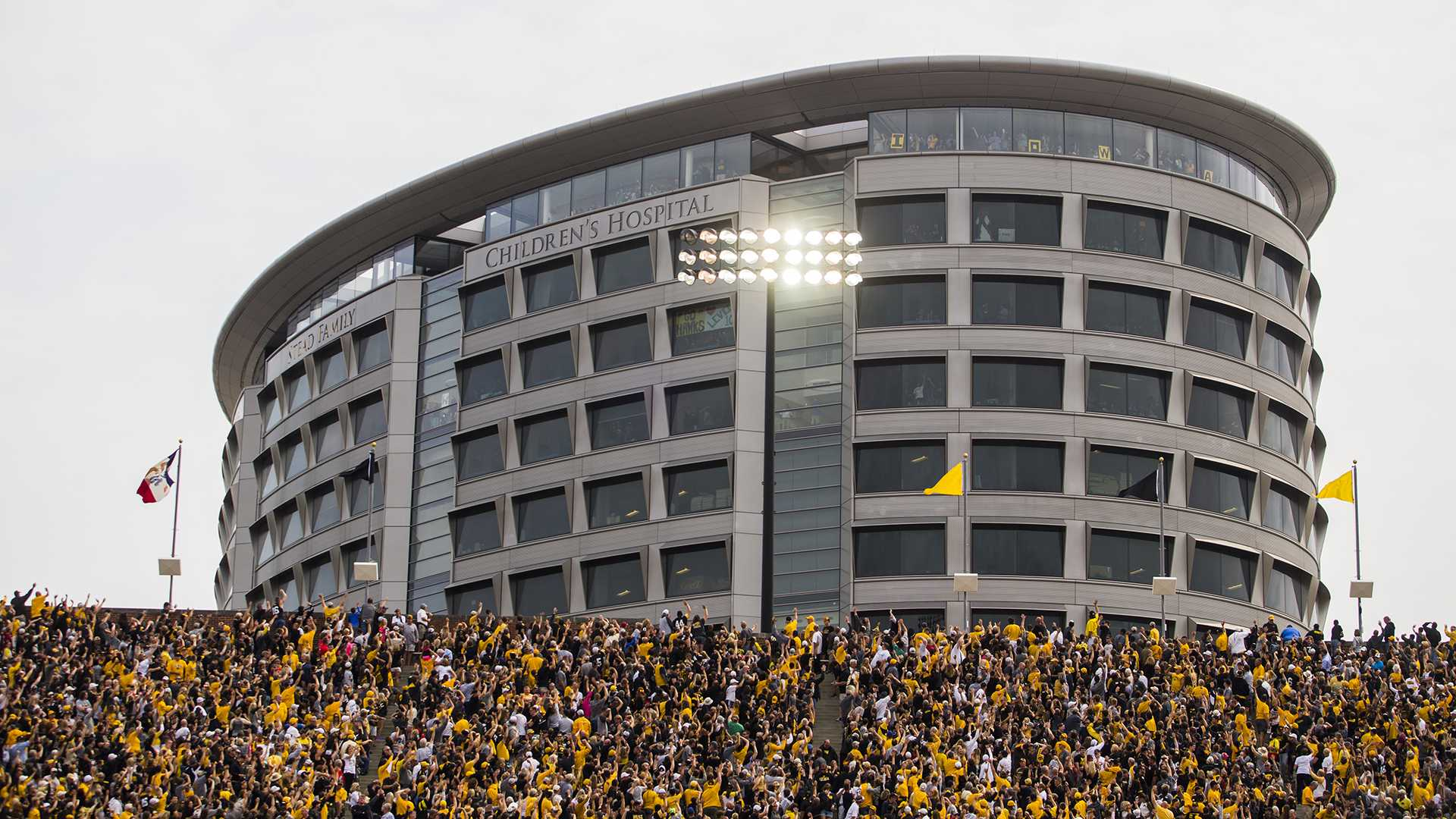Iowa fans wave to kids in the Stead Family Children's Hospital during an NCAA football game between Iowa and Wyoming in Kinnick Stadium on Saturday, Sept. 2, 2017. The Stead Family Children's hospital has an observation floor where families can go to watch games in Kinnick with a skybox-style view. (Joseph Cress/The Daily Iowan)
