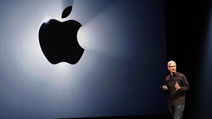 Apple CEO Tim Cook gets ready to introduce the Foo Fighters band during the product unveiling of the iPhone 5 at the Yerba Buena Center for the Arts in San Francisco, California on Wednesday, September 12, 2012. (Gary Reyes/San Jose Mercury News/MCT)