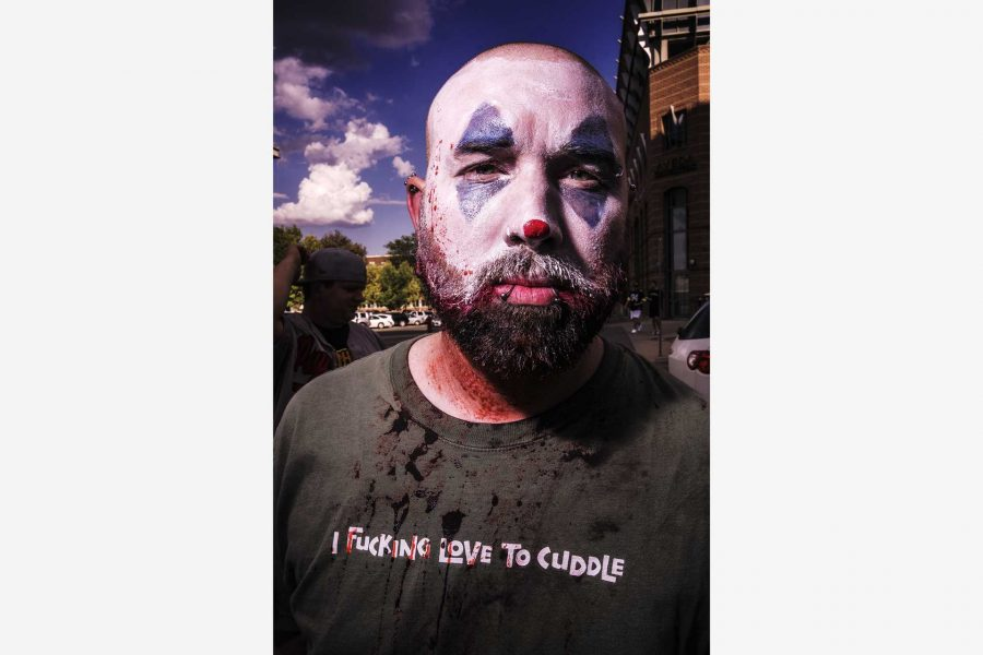 Sleepy the Juggalo poses for a portrait while waiting in line for the Insane Clown Posse concert at the Blue Moose on Saturday, Sept 23. 2017. Sleep stated that he loves how ICP takes care of the crowd and has never been disapointed at their shows. (James Year/The Daily Iowan)