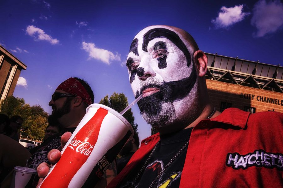 A Juggalo proudly displays his facepaint and Insane Clown Posse attire while waiting in line for the ICP concert at the Blue Moose on Saturday, Sept. 23, 2017. ICP is known as a Horrorcore rap group from Detroit, Michigan and has a reputation for eccentric performances alongside their devoted fanbase. (James Year/The Daily Iowan)