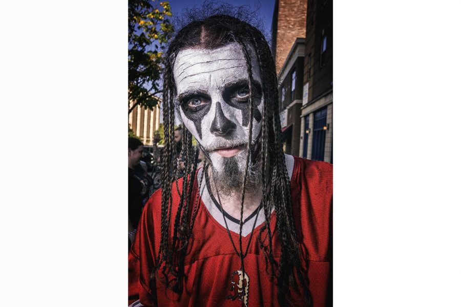 A Juggalo poses for a photograph while waiting in line for the Insane Clown Posse concert at the Blue Moose on Saturday, Sept. 23, 2017. The clown facepaint was heavily influenced by Insane Clown Posses love of professional wrestling. (James Year/The Daily Iowan)