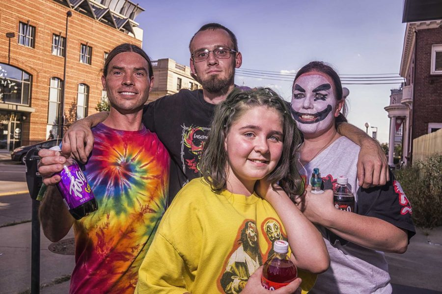 The Cheney family from Lincoln, Nebraska poses for a photograph while waiting in line for the Insane Clown Posse concert at the Blue Moose on Sunday, Sept. 24, 2017. The Cheneys made the 7 hour drive just to see the show. (James Year/The Daily Iowan)