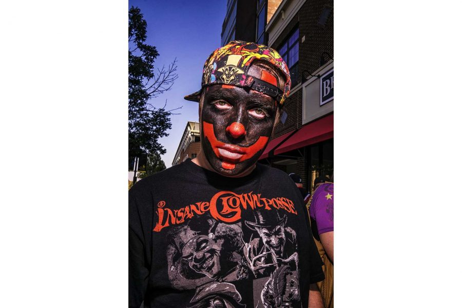 A Juggalo poses for a portrait while waiting in line for the Insane Clown Posse concert at the Blue Moose on Sunday, Sept. 23, 2017. Many Juggalos create their own designs and colors to show their individuality in the crowd. (James Year/The Daily Iowan