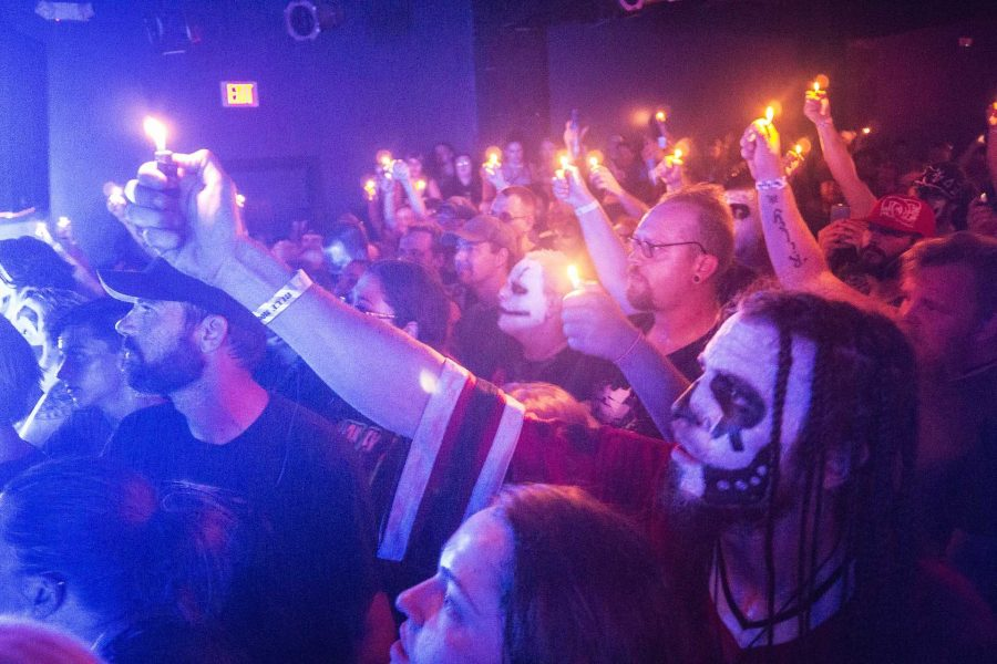 Concertgoers and Juggalos wave their lighters to a song by Big Hoodoo at the Blue Moose on Saturday, Sept. 23, 2017. (James Year/The Daily Iowan)