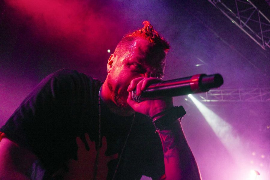 An Insane Clown Posse opening act known as Lyte raps fast paced lyrics to the crowd at the Blue Moose on Saturday, Sept. 23, 2017. (James Year/The Daily Iowan