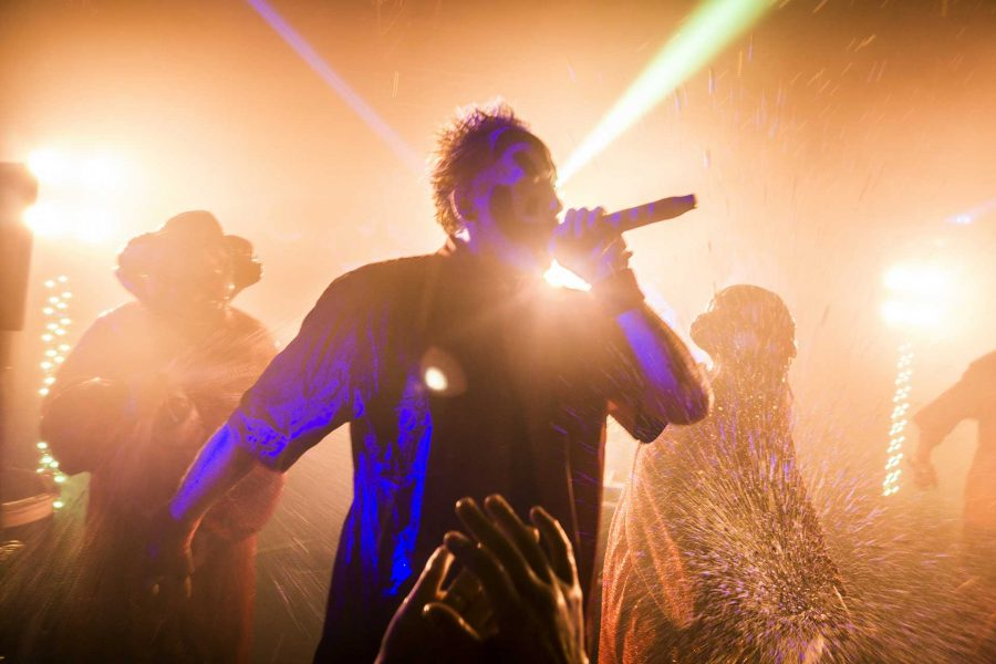 Violent J, also known as Joseph Bruce, raps while backup performers dressed as clowns spray 2-liter bottlers of Faygo directly into the crowd at the Blue Moose on Saturday, Sept. 23, 2017. (James Year/The Daily Iowan)