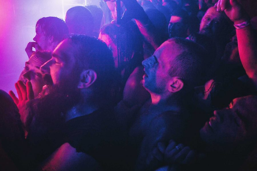 Soaked Juggalos and concertgoers enjoy the performance by Insane Clown Posse in the packed venue in the Blue Moose on Saturday, Sept. 23, 2017. The crowd coped with high temperatures while many stage dived, crowdsurfed, and moshed throughout the crowd. (James Year/The Daily Iowan)