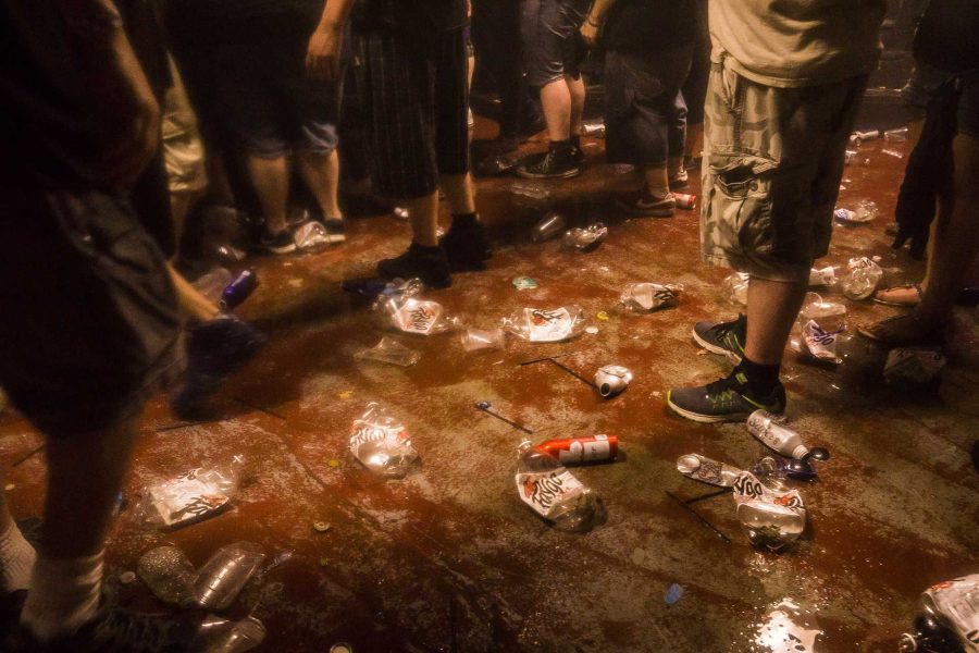 Juggalos and concertgoers head to the exit immediately after the Insane Clown Posse concert finished at the Blue Moose on Saturday, Sept. 23, 2017. ICP uses 700 liters of soda on average to spray on the crowd and takes a lot of effort to clean up after the performance. (James Year/The Daily Iowan)