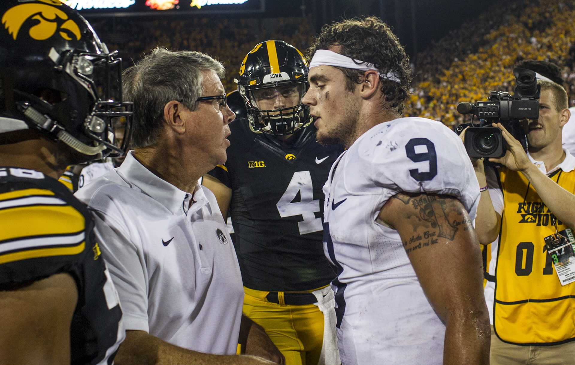 Iowa quarterbacks coach Ken O'Keefe exchanges words with Penn State quarterback Trace McSorley after McSorley punted the ball in celebration after Iowa's game against Penn State at Kinnick Stadium on Sept. 23, 2017. Penn State defeated Iowa 21-19 on a last second touchdown pass.
