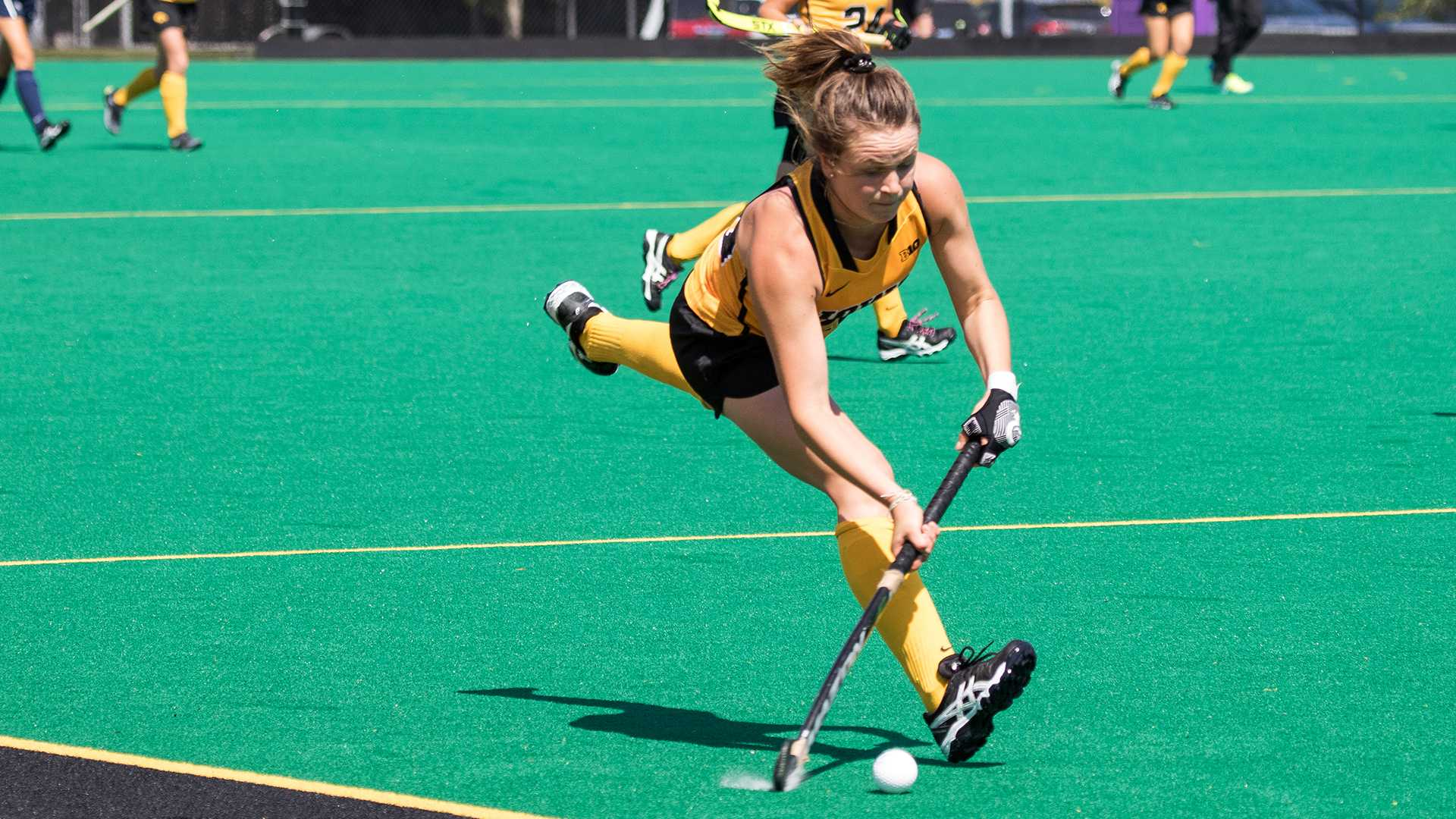 Iowa's Madeleine Murphy lunges for the ball during the Iowa-University of New Hampshire field hockey match on Sunday, 10 September, 2017. Iowa defeated UNH by a final score of 7-1. (David Harmantas/The Daily Iowan)