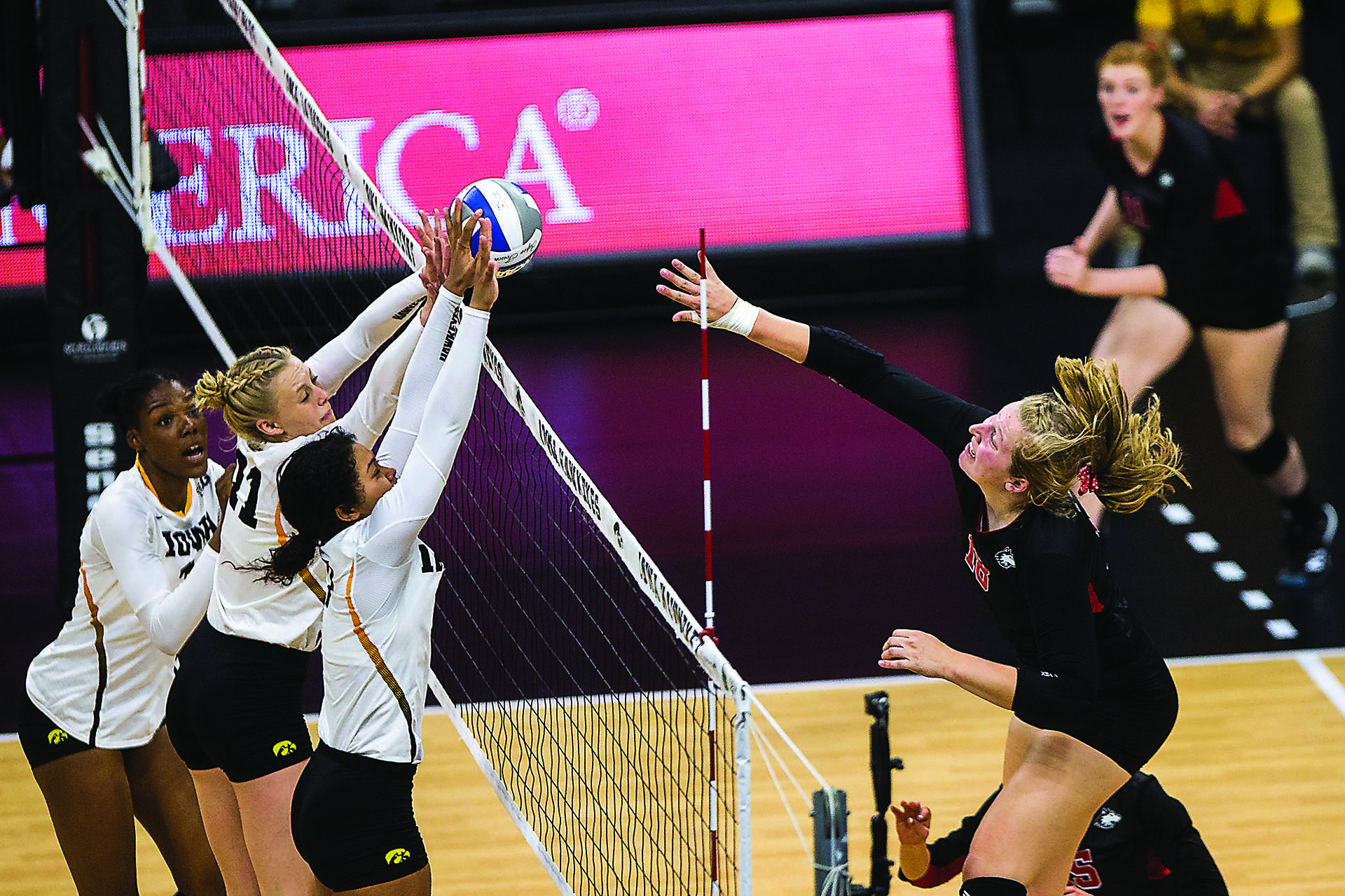 Iowa's Taylor Louis, Kelsey O'Neill, and Brie Orr block a spike during the match between Iowa and Northern Illinois inside Carver-Hawkeye Arena on Friday, Sept. 8, 2017. The Hawkeyes went on to defeat the Huskies 3-0. (Ben Smith/The Daily Iowan)
