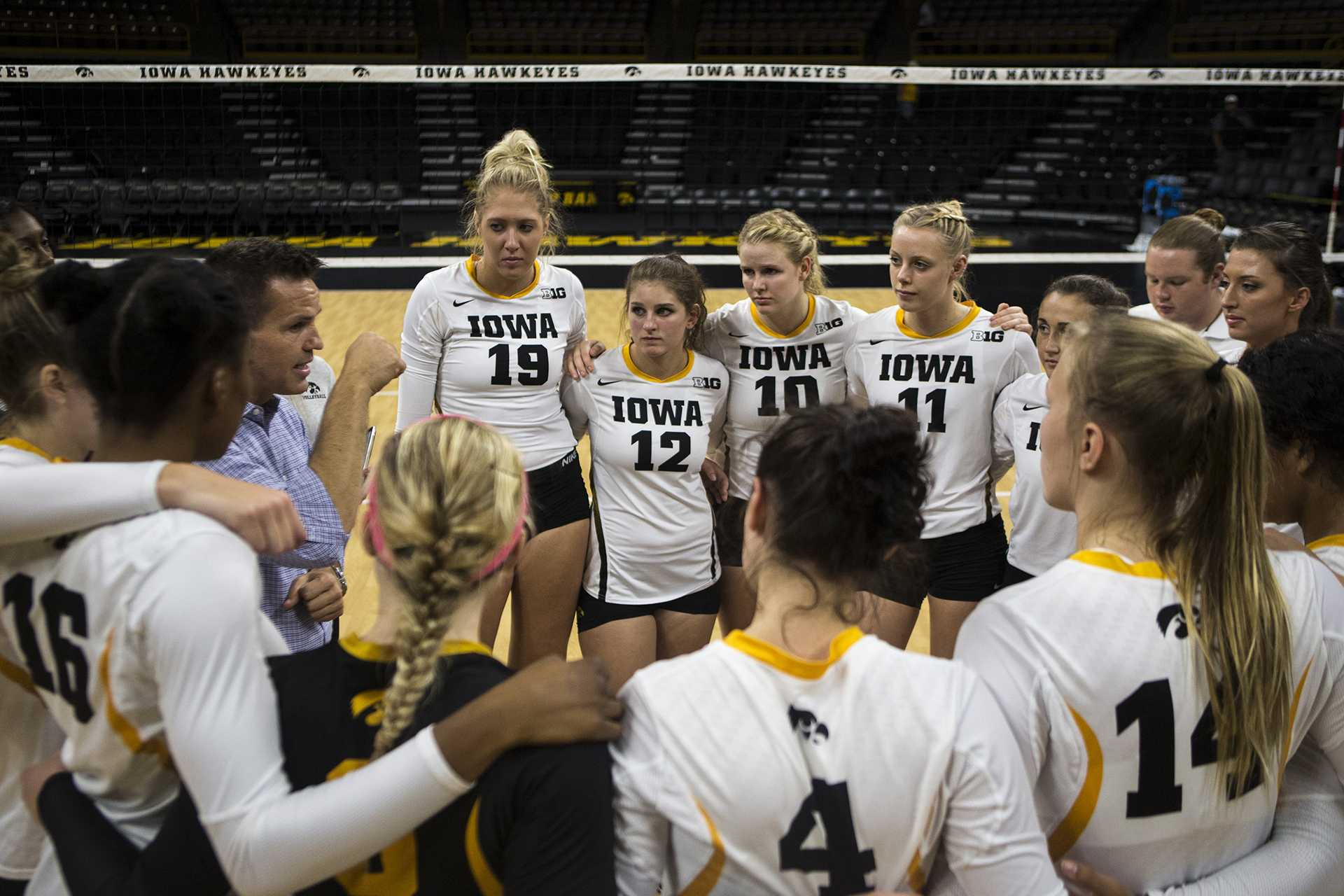 Iowa head coach Bond Shymansky speaks to the team after the match between Iowa and Northern Illinois inside Carver-Hawkeye Arena on Friday, Sept. 8, 2017. The Hawkeyes went on to defeat the Huskies 3-0. (Ben Smith/The Daily Iowan)