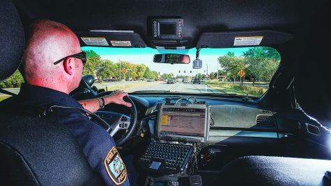 Sgt. Derek Frank of the Iowa City police patrols on Highway 6 on Wednesday. Frank has been on the force for 19 years. (James Year/The Daily Iowan)