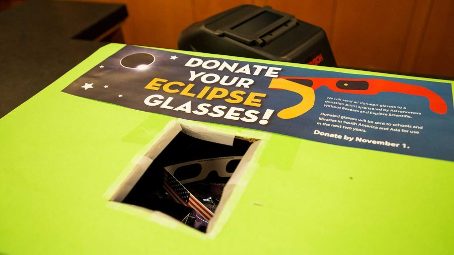A collection box for used eclipse viewing glasses is seen in the Iowa City Public Library on Monday, Sept. 25, 2017. The library is collecting the glasses for shipment to schools overseas. (David Harmantas/The Daily Iowan)