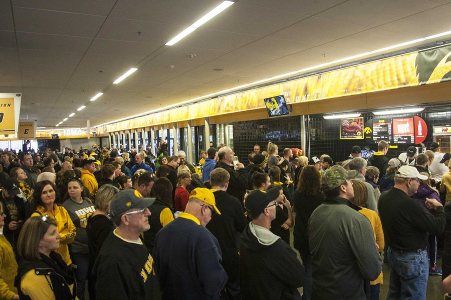 Fans wait in line for concessions before a mens basketball game in Carver-Hawkeye Arena on Sunday, Jan. 1, 2017. The Hawkeyes defeated the Wolverines, 86-83 in OT. (The Daily Iowan/Joseph Cress)
