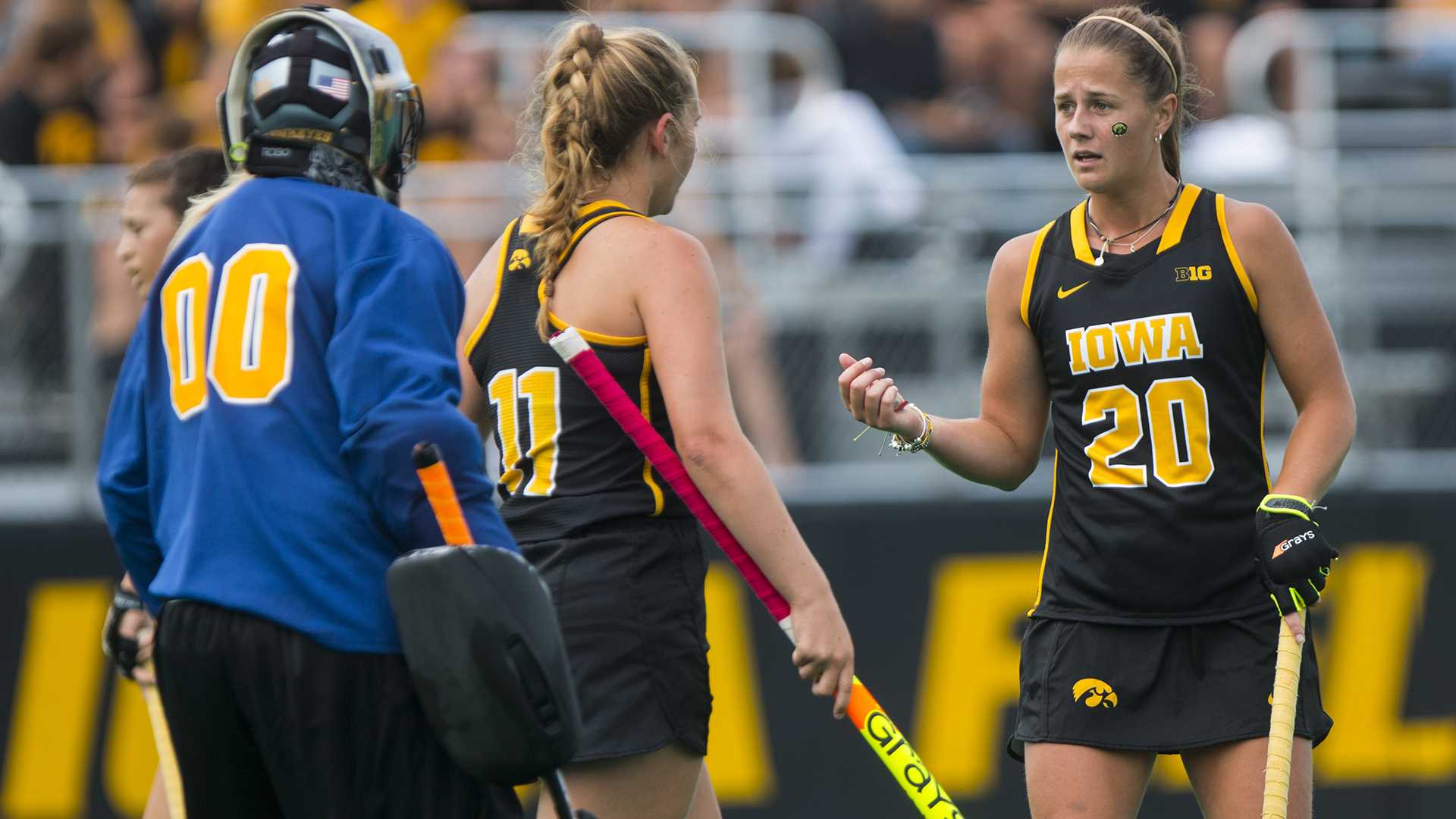 Iowa's Sophie Sunderland (20) talks with Kaite Birch (11) and Katie Jones (00) during a field hockey game during the Big Ten/ACC Challenge at Grant Field in Iowa City on Saturday, Aug. 26, 2017. The Hawkeyes fell to Wake Forest, 3-2. (Joseph Cress/The Daily Iowan)