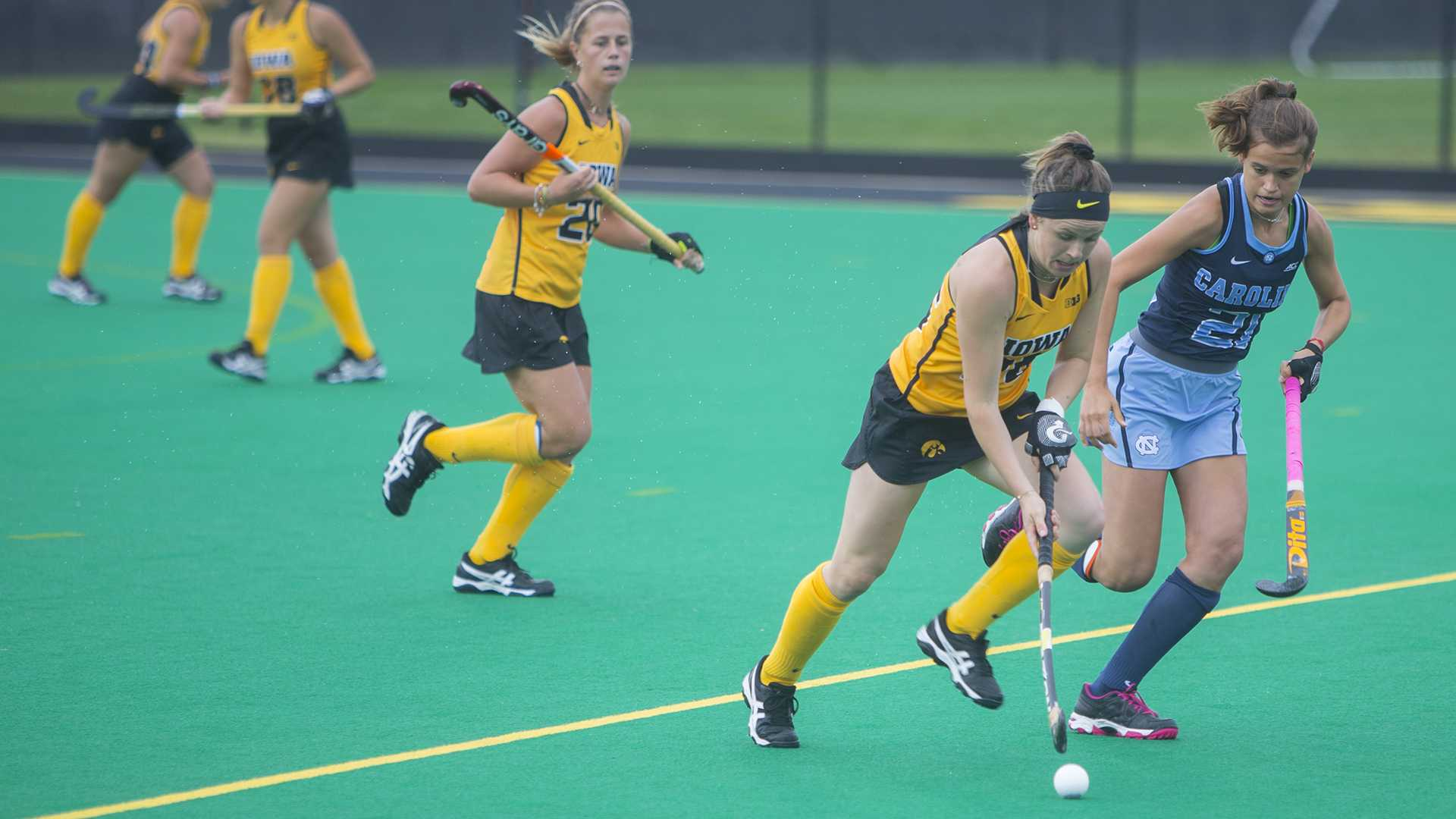 Iowa's Madeleine Murphy (26) runs from UNC's Eva Smolenaars (21) during a field hockey game during the Big Ten/ACC Challenge at Grant Field in Iowa City on Sunday, Aug. 27, 2017. The Hawkeyes fell to the Tarheels, 3-0. (Lily Smith/The Daily Iowan)