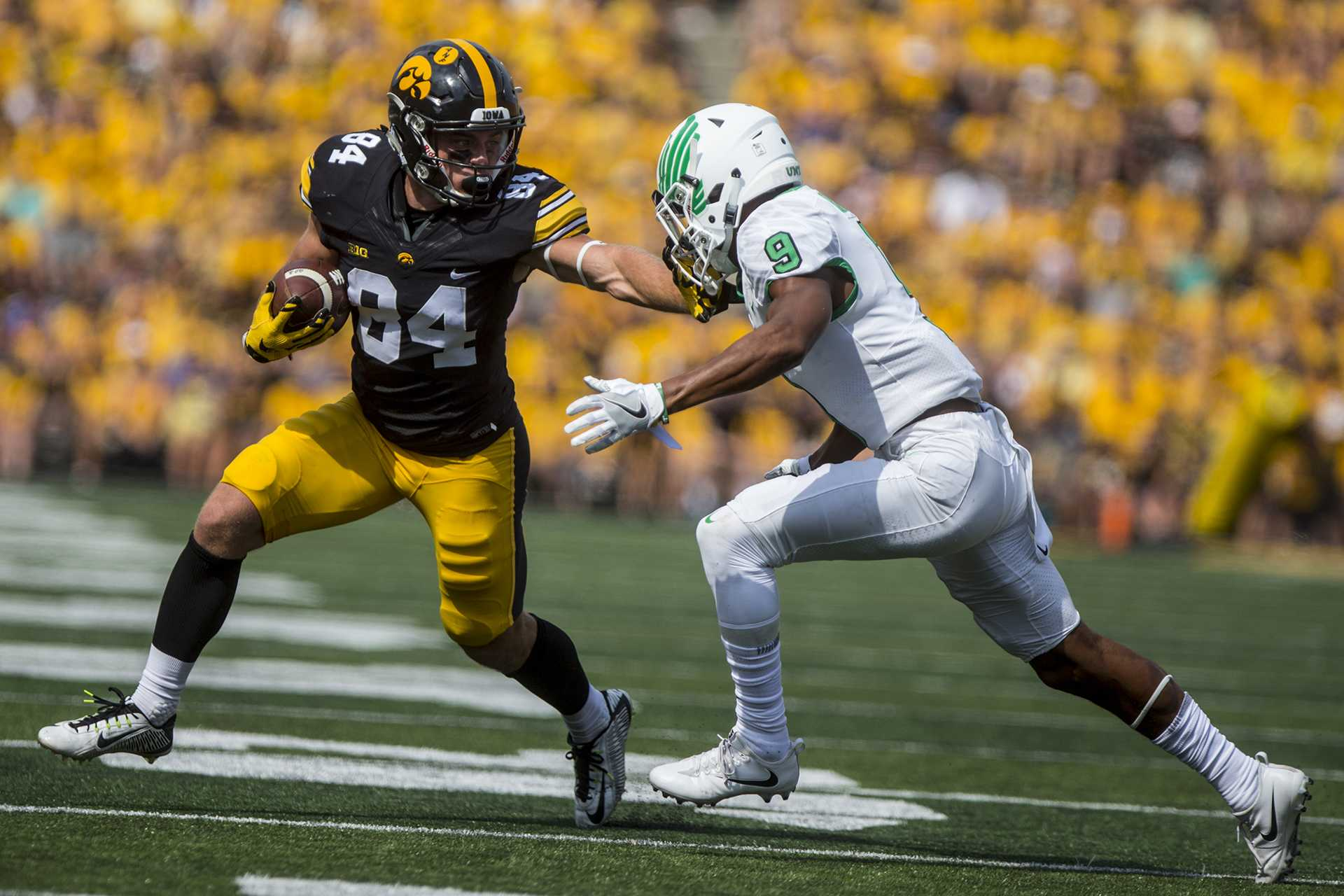 Iowa wide receiver Nick Easley stiff arms North Texas defensive back Nate Brooks during the game between Iowa and North Texas at Kinnick Stadium on Saturday, Sept. 16, 2017. The Hawkeyes went on to defeat the Mean Green 31-14. (Ben Smith/The Daily Iowan)
